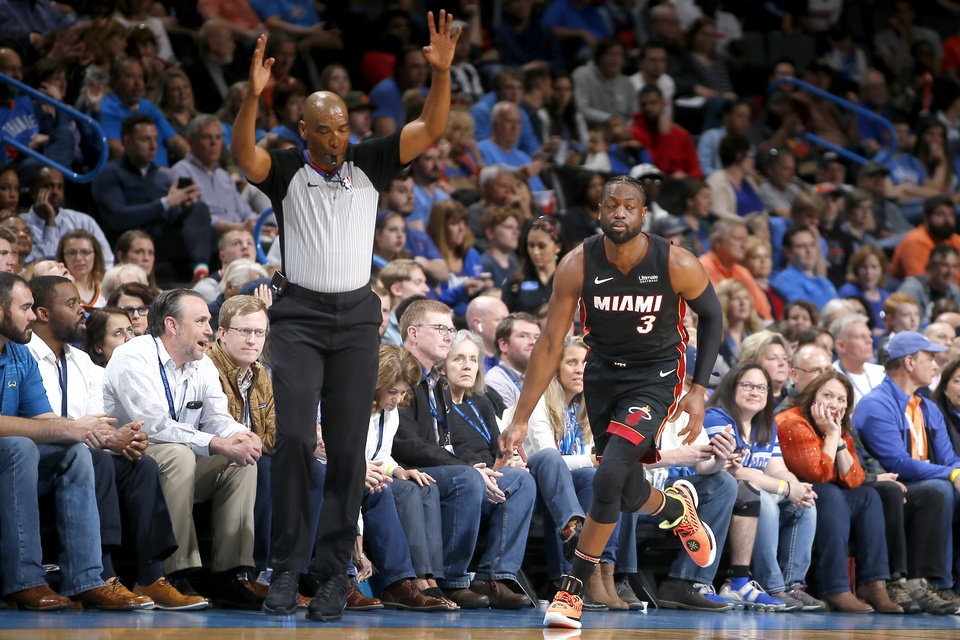 Photo - Miami's Dwyane Wade (3) celebrates after a 3-pointer during an NBA basketball game between the Oklahoma City Thunder and the Miami Heat at Chesapeake Energy Arena in Oklahoma City, Monday, March 18, 2019. Photo by Bryan Terry, The Oklahoman