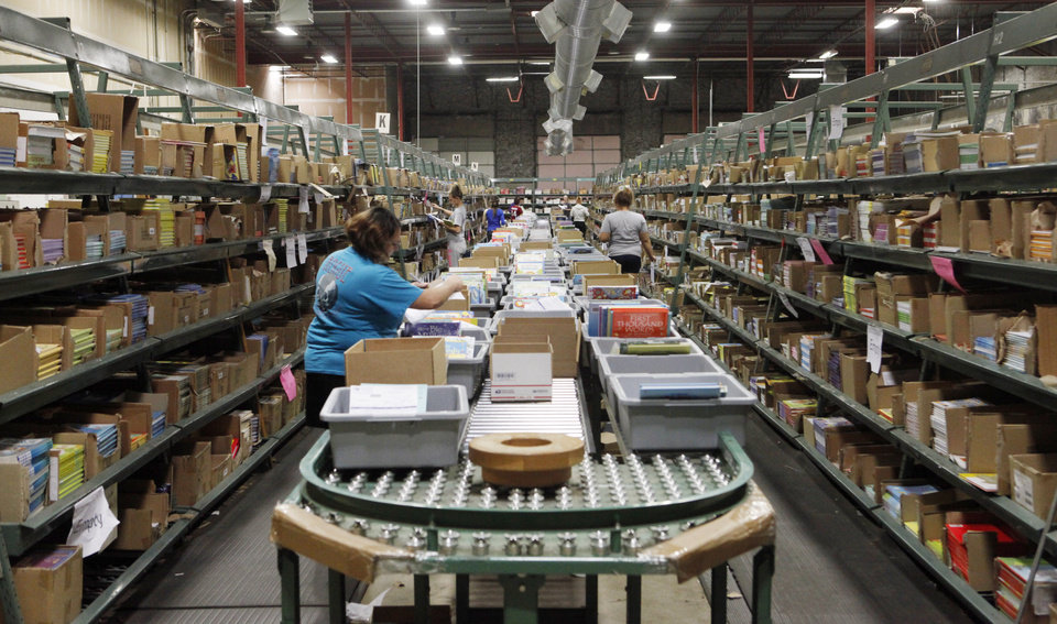 Photo -  Educational Development Corp.'s direct sales division is growing quickly, keeping workers busy on the book
