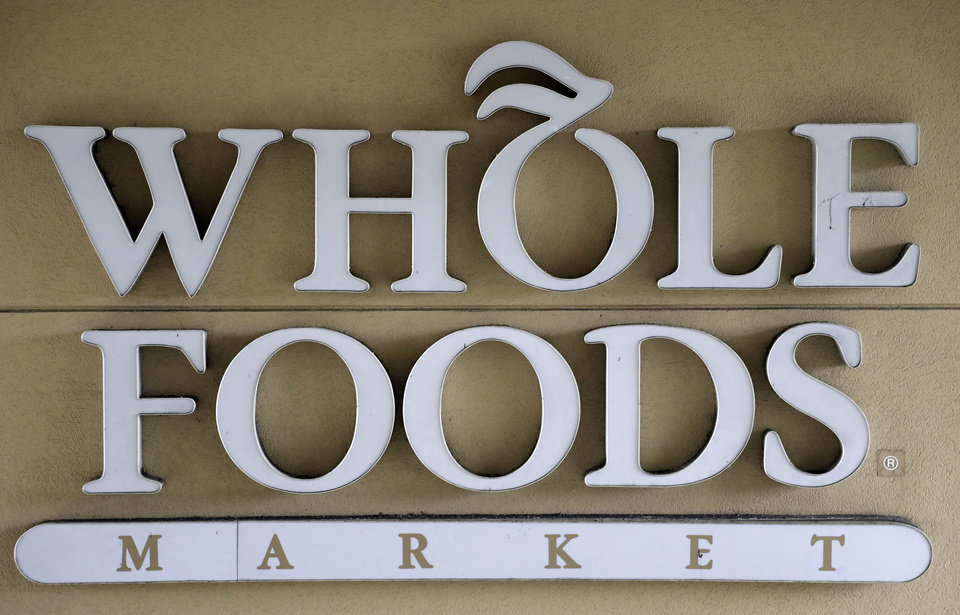 Photo - A sign at a Whole Foods Market greets shoppers, Monday, Aug. 28, 2017, in Tampa, Fla. Parent company Amazon has announced they will drop the prices on certain food items at the stores. (AP Photo/Chris O'Meara)