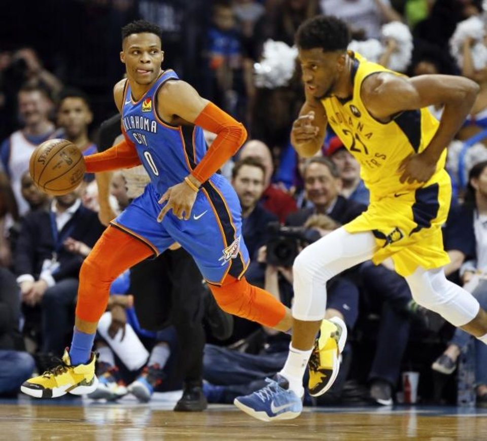 Photo -  Oklahoma City's Russell Westbrook (0) pushes the ball on a fast break near Indiana's Thaddeus Young (21) on Wednesday night at Chesapeake Energy Arena in Oklahoma City. The Thunder won 107-99 as Westbrook recorded another triple-double. [Nate Billings/The Oklahoman]