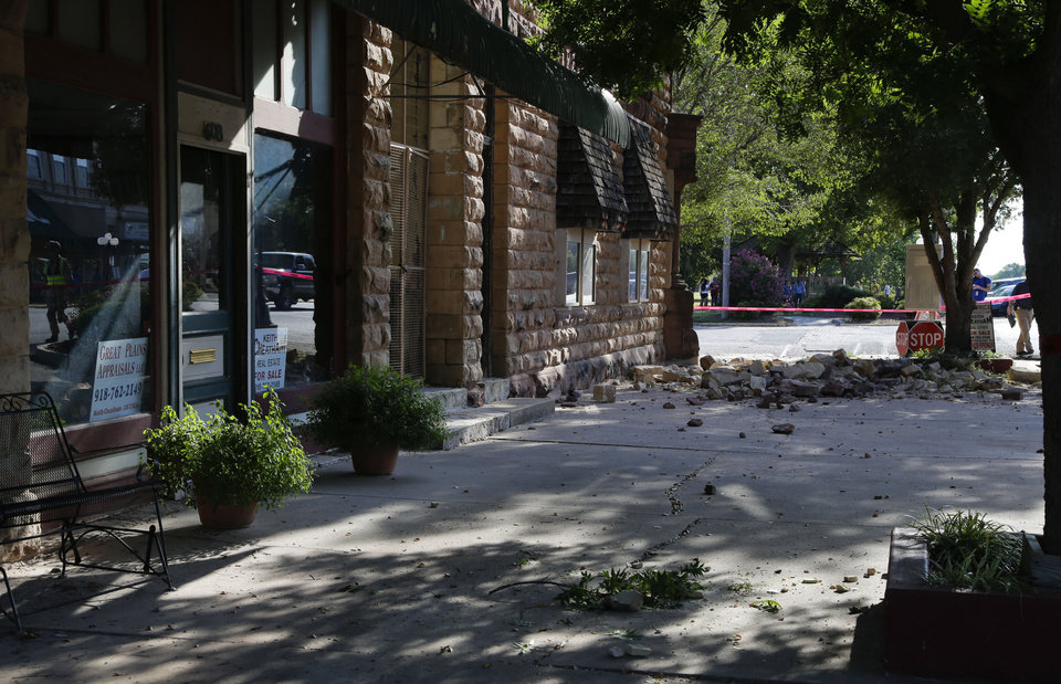 Photo - Rubble lay on the sidewalk from a building on the corner of 6th and Harris after a 5.6 earthquake in Pawnee, Sat. Sept. 3, 2016. JESSIE WARDARSKI/Tulsa World