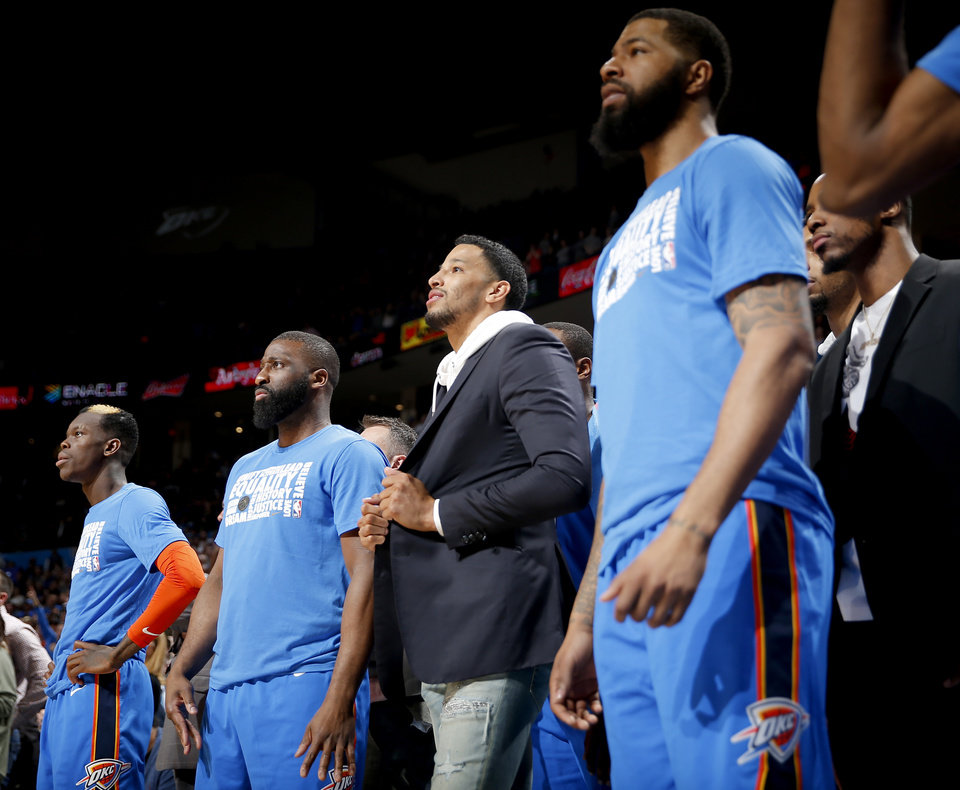 Photo - Oklahoma City's Andre Roberson (21) stands with teammates during the NBA game between the Oklahoma City Thunder and the Utah Jazz at the Chesapeake Energy Arena, Saturday, Feb. 23, 2019. Photo by Sarah Phipps, The Oklahoman