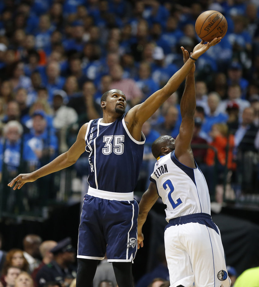 Photo - Oklahoma City's Kevin Durant (35) reaches for the ball over Dallas' Raymond Felton (2) during Game 3 of the first round series between the Oklahoma City Thunder and the Dallas Mavericks in the NBA playoffs at American Airlines Center in Dallas, Thursday, April 21, 2016. The Thunder won 131-102. Photo by Bryan Terry, The Oklahoman