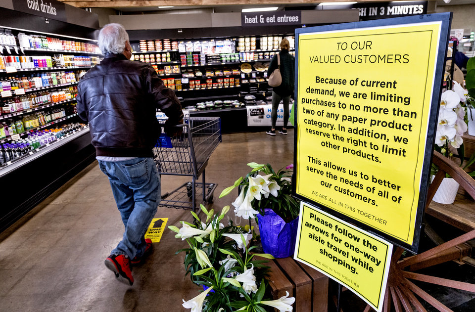 Photo - Signs notify customers of new shopping procedures for the Homeland located at 1108 NW 18th St. in Oklahoma City, Okla. on Monday, April 13, 2020. [Chris Landsberger/The Oklahoman]
