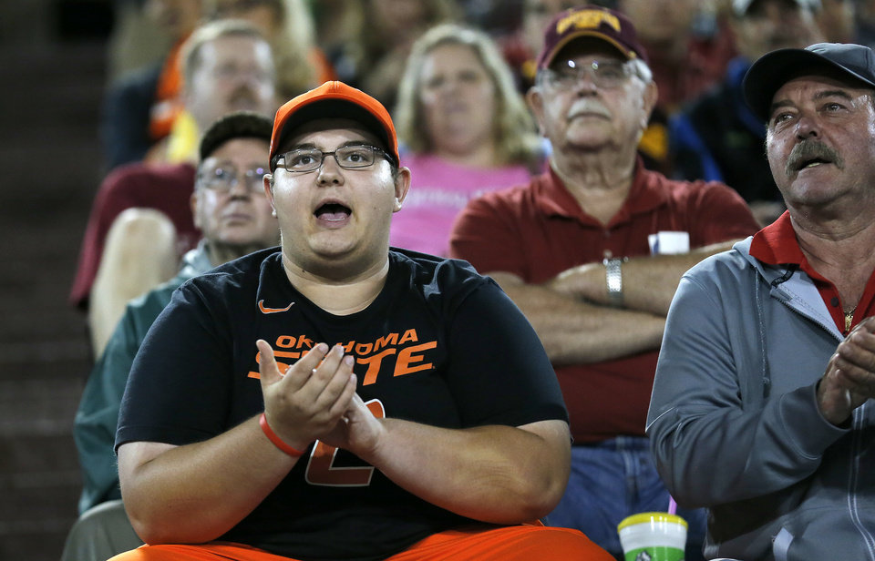 Photo - Nick Lozanovski cheers on the Cowboys during the college football game between the Central Michigan Chippewas and the Oklahoma State University Cowboys at the Kelly-Shorts Stadium in Mount Pleasant, Mich., Thursday, Sept. 3, 2015. Photo by Sarah Phipps, The Oklahoman