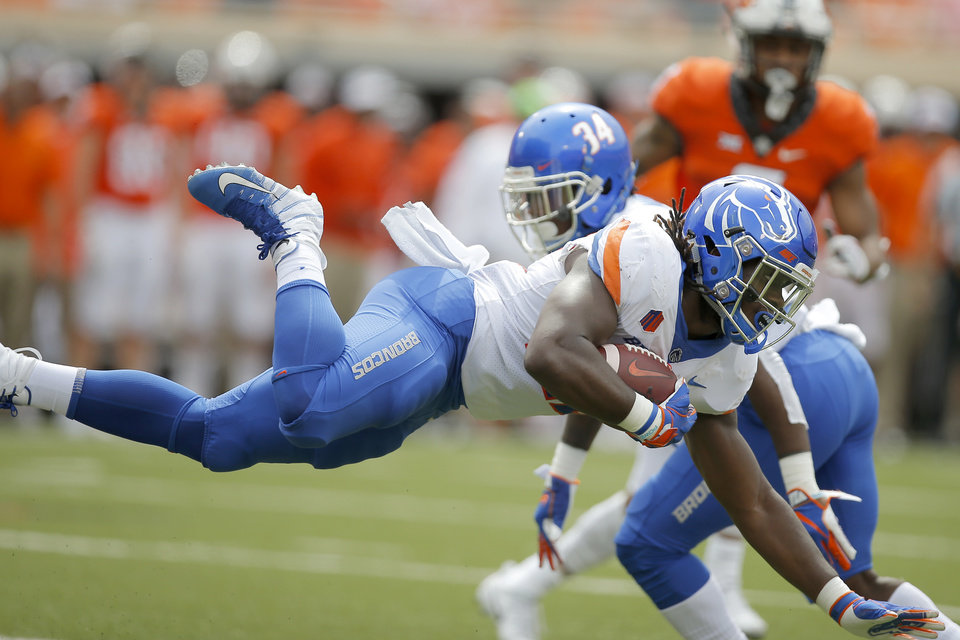 Photo - Boise State's Alexander Mattison (22)  is brought down while returning a kick during a college football game between the Oklahoma State University Cowboys (OSU) and the Boise State Broncos at Boone Pickens Stadium in Stillwater, Okla., Saturday, Sept. 15, 2018. Oklahoma State won 44-21. Photo by Bryan Terry, The Oklahoman