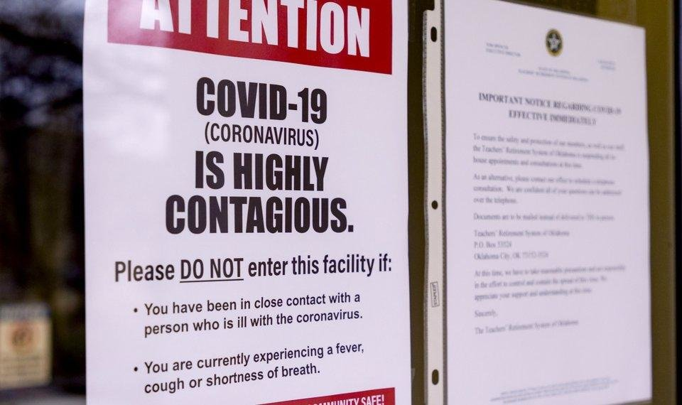 Photo - Signs that are posted about the Coronavirus on the doors of the Oklahoma State Department of Education in Oklahoma City, Okla. on Monday, March 16, 2020. Oklahoma's State Superintendent of Public Instruction, Joy Hofmeister announced the closing of public school till April 6 to combat the spread of the Coronavirus.  [Chris Landsberger/The Oklahoman]