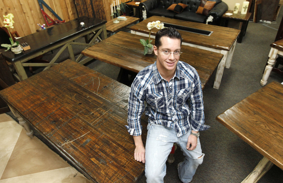 Amazing Furniture Builder Jason Thomas Stands Among Some Of The Reclaimed Wood  Furniture His Company Creates In