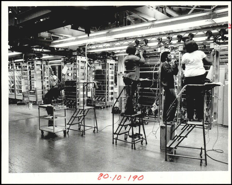 Photo -  Workers assembled telephone switching equipment at the plant in 1983. [The Oklahoman Archives]