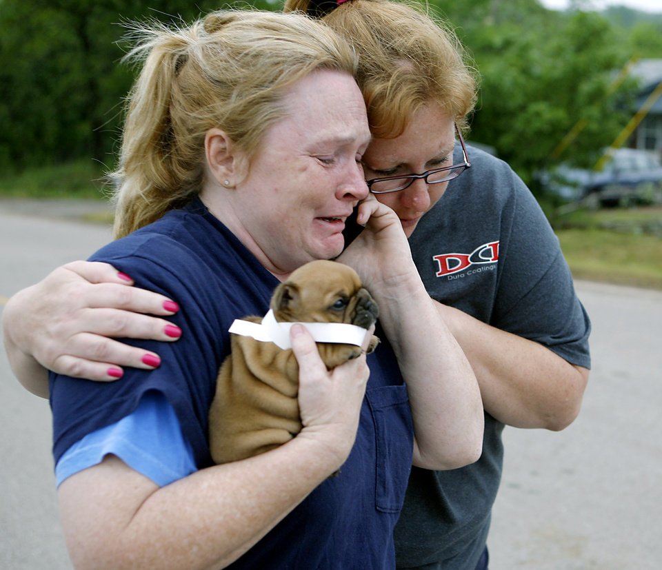 Photo - TORNADO / STORM DAMAGE / DOG / FIND: Shelley Heston Bolles (left) and Gidget Miller (right) react as they celebrate finding a 4-week-old puppy that belongs to Heston Bolles in Little Axe, Oklahoma on Tuesday, May 11, 2010. Animal Control officers found the puppy, that belongs to Shelly Heston Bolles, near her home that was destroyed during the storms. The puppy was unharmed. By John Clanton, The Oklahoman ORG XMIT: KOD