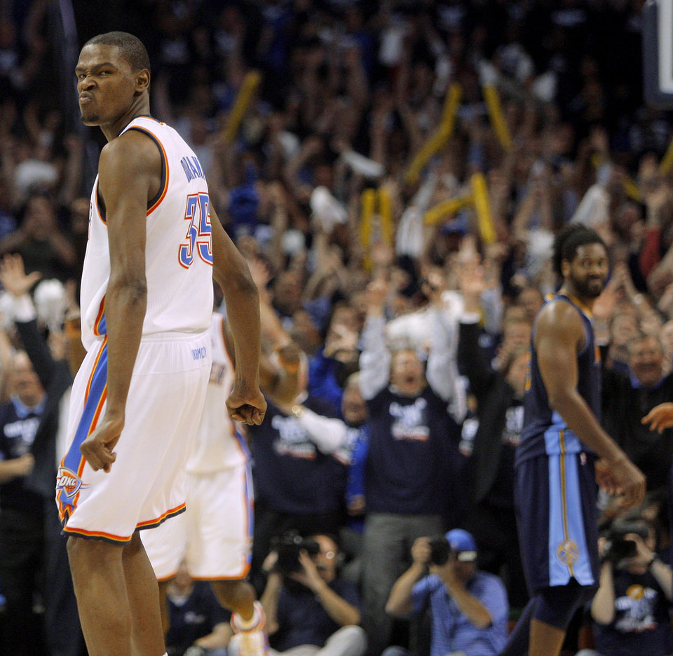 Photo - Oklahoma City's Kevin Durant (35) reacts after making the final basket during the NBA basketball game between the Denver Nuggets and the Oklahoma City Thunder in the first round of the NBA playoffs at the Oklahoma City Arena, Wednesday, April 27, 2011. Photo by Bryan Terry, The Oklahoman