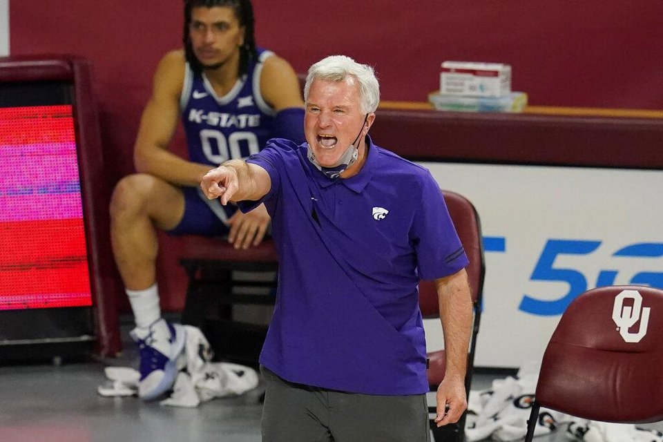 Photo - Kansas State coach Bruce Weber shouts to players during the second half of the team's NCAA college basketball game against Oklahoma, Tuesday, Jan. 19, 2021, in Norman, Okla. (AP Photo/Sue Ogrocki)