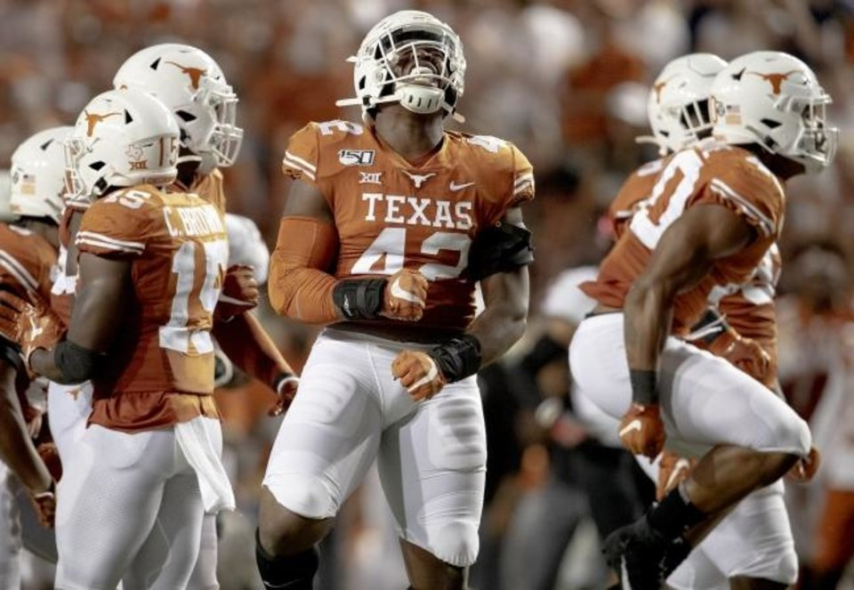 Photo -  Texas defensive lineman Marqez Bimage celebrates a stop against Oklahoma State during their game Saturday in Austin, Texas. [Nick Wagner/Austin American-Statesman]