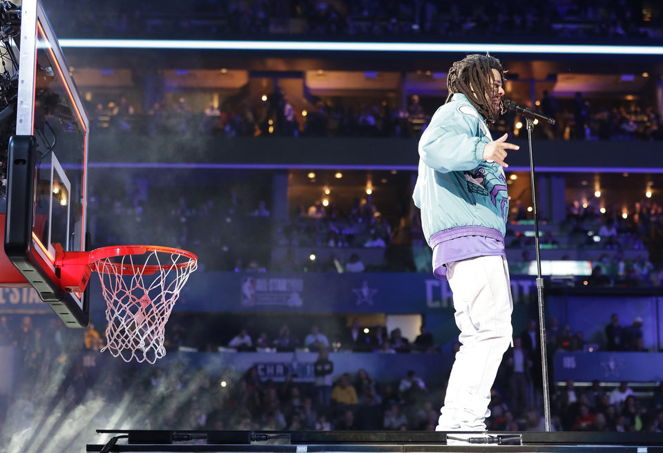 Photo - Rapper J. Cole performs at halftime during NBA All-Star basketball game, Sunday, Feb. 17, 2019, in Charlotte, N.C. (AP Photo/Chuck Burton)