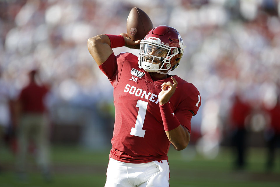 Photo - Oklahoma's Jalen Hurts (1) warms up before a college football game between the University of Oklahoma Sooners (OU) and the Houston Cougars at Gaylord Family-Oklahoma Memorial Stadium in Norman, Okla., Sunday, Sept. 1, 2019. [Bryan Terry/The Oklahoman]
