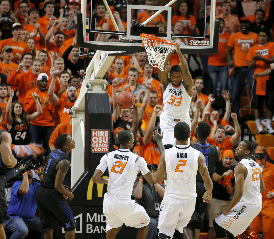 Photo - Marcus Smart (33) dunks the ball during an NCAA college basketball game between Oklahoma State and Memphis at Gallagher- Iba Arena in Stillwater, Okla., Tuesday, Nov. 19, 2013. Photo by Bryan Terry, The Oklahoman