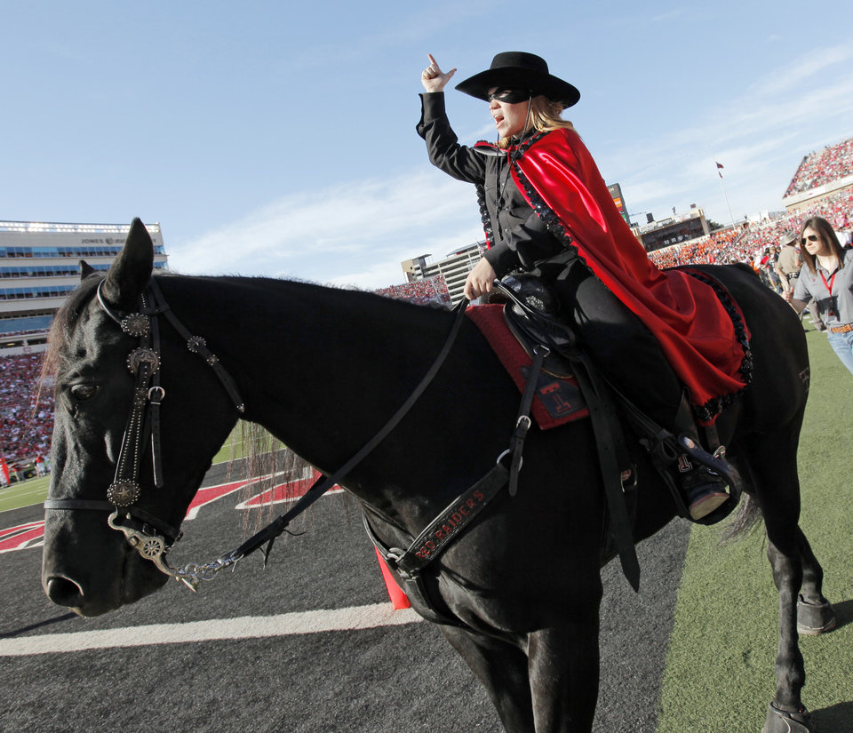 Photo - The Texas Tech Masked Rider roams the sidelines during the college football game between the Oklahoma State University Cowboys and Texas Tech University Red Raiders at Jones AT&T Stadium in Lubbock, Texas, Saturday, October 16, 2010. OSU won, 34-17. Photo by Nate Billings, The Oklahoman
