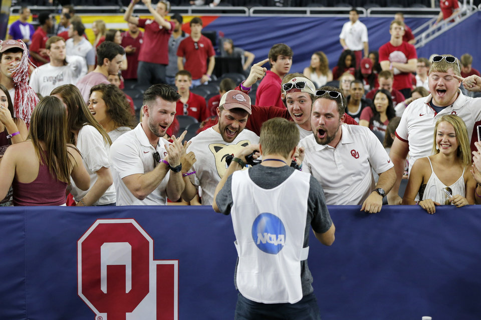 Photo - Oklahoma fans cheer before the national semifinal between the Oklahoma Sooners (OU) and the Villanova Wildcats in the Final Four of the NCAA Men's Basketball Championship at NRG Stadium in Houston, Saturday, April 2, 2016. Photo by Nate Billings, The Oklahoman