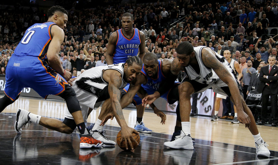 Photo - Oklahoma City's Serge Ibaka (9) fights for the ball beside San Antonio's LaMarcus Aldridge (12) and San Antonio's Kawhi Leonard (2) as Russell Westbrook (0) watches during the last seconds of Game 2 of the second-round series between the Oklahoma City Thunder and the San Antonio Spurs in the NBA playoffs at the AT&T Center in San Antonio, Monday, May 2, 2016. Oklahoma City won 98-97. Photo by Bryan Terry, The Oklahoman