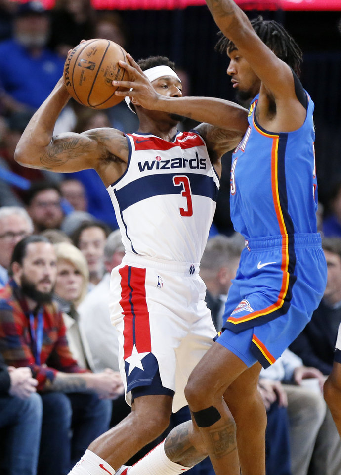 Photo - Oklahoma City's Terrance Ferguson (23), right, defends Washington's Bradley Beal (3) in the first quarter during an NBA basketball game between the Oklahoma City Thunder and the Washington Wizards at Chesapeake Energy Arena in Oklahoma City, Friday, Oct. 25, 2019. [Nate Billings/The Oklahoman]