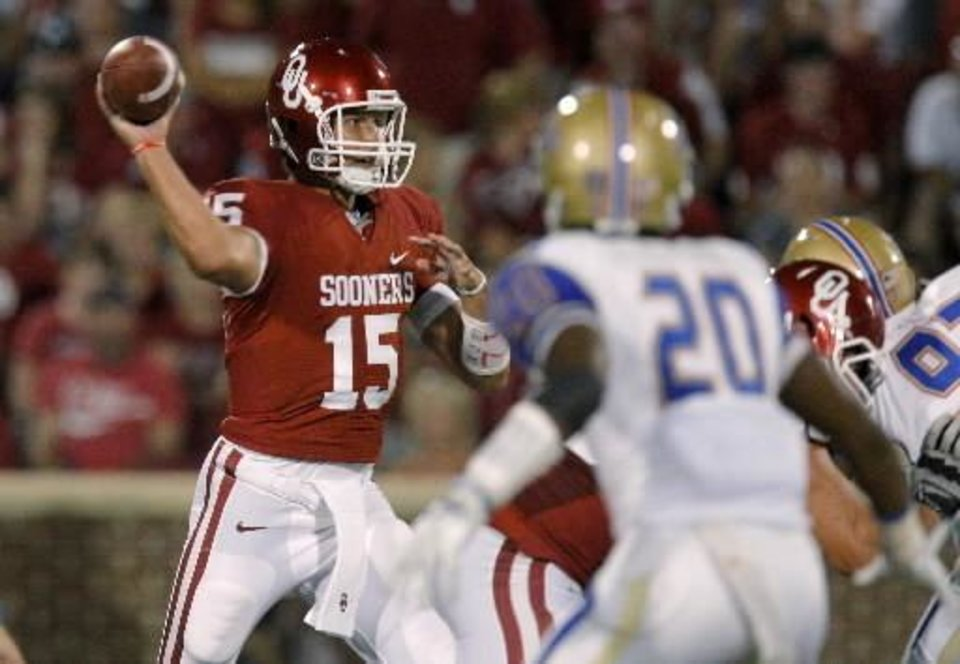 Photo - Oklahoma's Drew Allen (15) passes the ball during the college football game between the University of Oklahoma Sooners ( OU) and the Tulsa University Hurricanes (TU) at the Gaylord Family-Oklahoma Memorial Stadium on Saturday, Sept. 3, 2011, in Norman, Okla. Oklahoma won 47-14. Photo by Bryan Terry