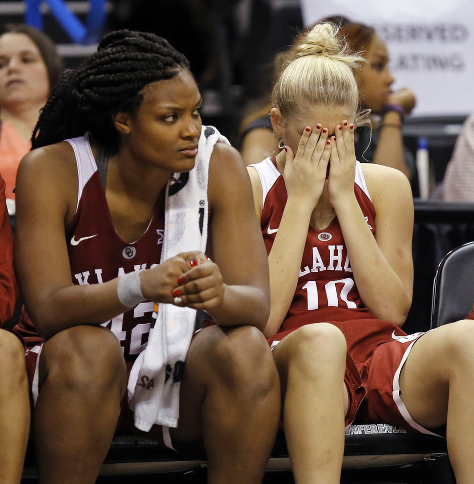 Photo - Oklahoma's Kaylon Williams (42), left, and Peyton Little (10) sit on the bench in the fourth quarter of a semifinal game in the Big 12 Women's Basketball Championship between the Oklahoma Sooners (OU) and the Baylor Lady Bears at Chesapeake Energy Arena in Oklahoma City, Sunday, March 6, 2016. Baylor won 84-57. Photo by Nate Billings, The Oklahoman