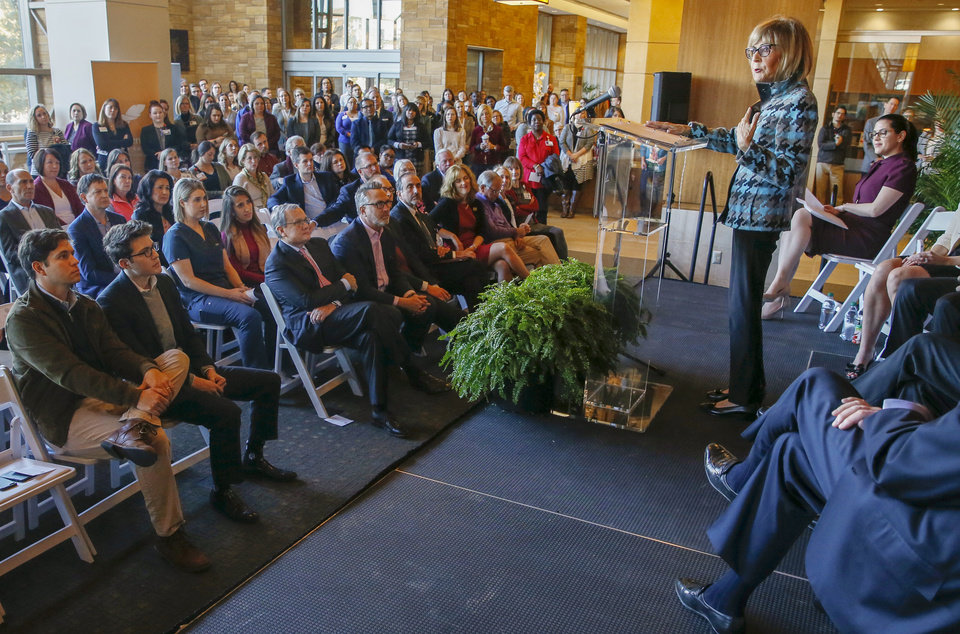 Photo - Cancer patient Susan Laurence speaks during the announcement of a $20 million gift from Peggy and Charles Stephenson to the Stephenson Cancer Center, 800 NE 10 St., in Oklahoma City, Friday, Nov. 15, 2019. [Nate Billings/The Oklahoman]