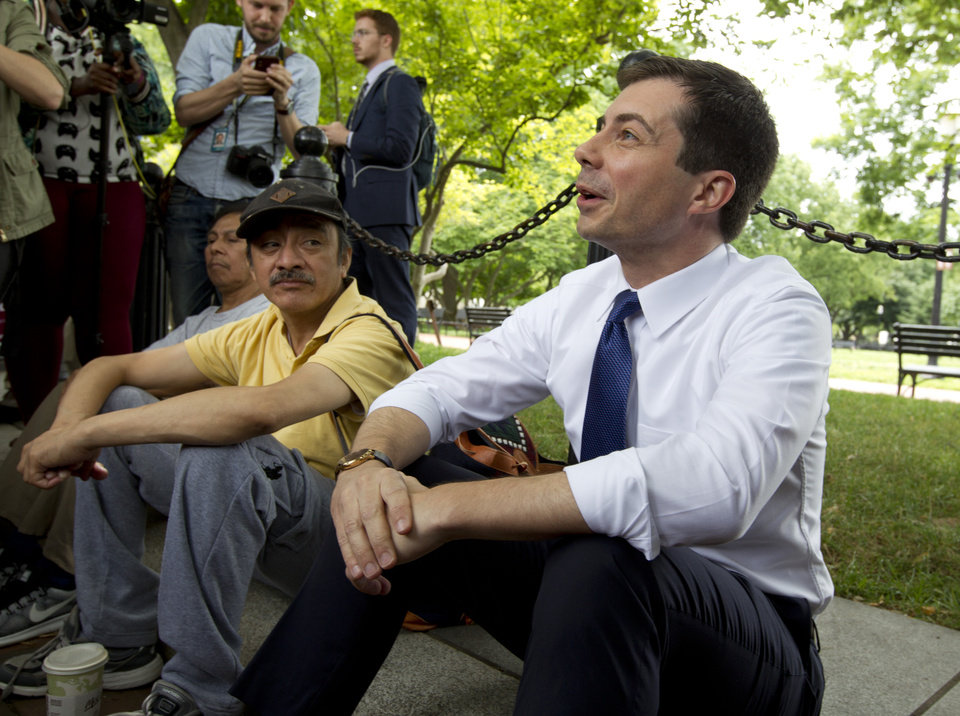 Photo -  Democratic presidential candidate Mayor Pete Buttigieg, right, attends a rally protesting against President Donald Trump policies outside of the White House in Washington, Wednesday, June 12, 2019. (AP Photo/Jose Luis Magana)