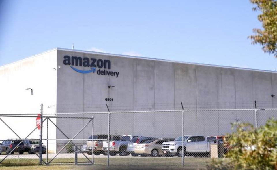 Photo -  Amazon moved into a 312,120-square-foot mega warehouse, nearly 20 years old but retrofitted, at 6801 S Air Depot Blvd., in June. [SARAH PHIPPS/THE OKLAHOMAN]