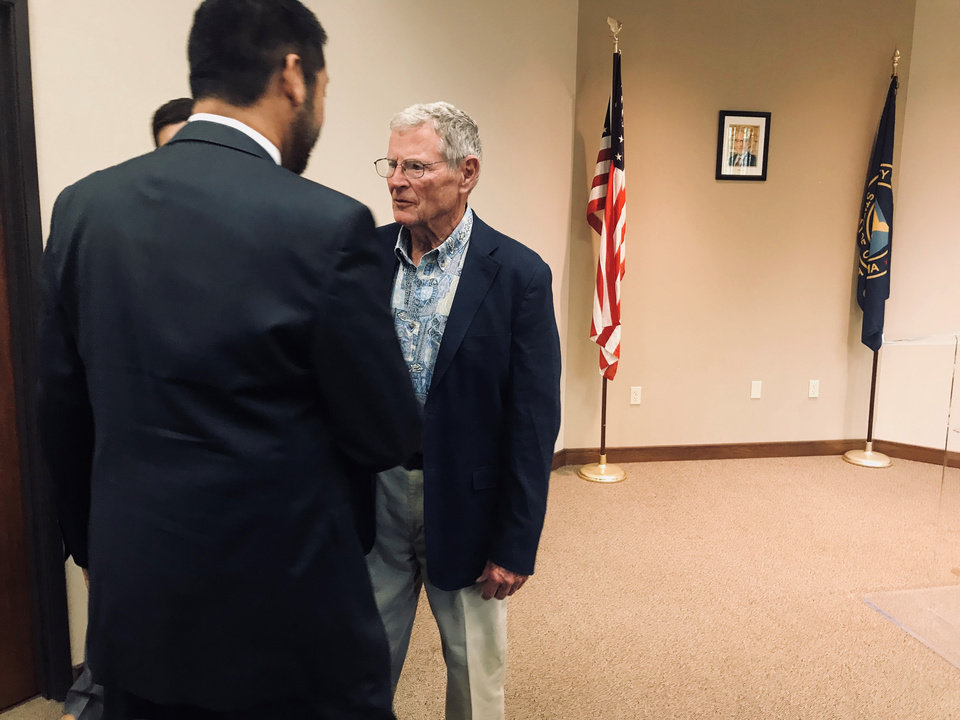 Photo -  U.S. Sen. Jim Inhofe, R-Tulsa, greets guests at the Midwest City Chamber of Commerce on Thursday. [Photo by Justin Wingerter, The Oklahoman]