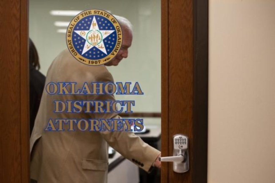 Photo -  David Thomas, District Attorney for District 3 (Greer, Harmon, Jackson, Kiowa and Tillman Counties), closes the door on June 20 at the start of the District Attorneys Association meeting. [Whitney Bryen/Oklahoma Watch]