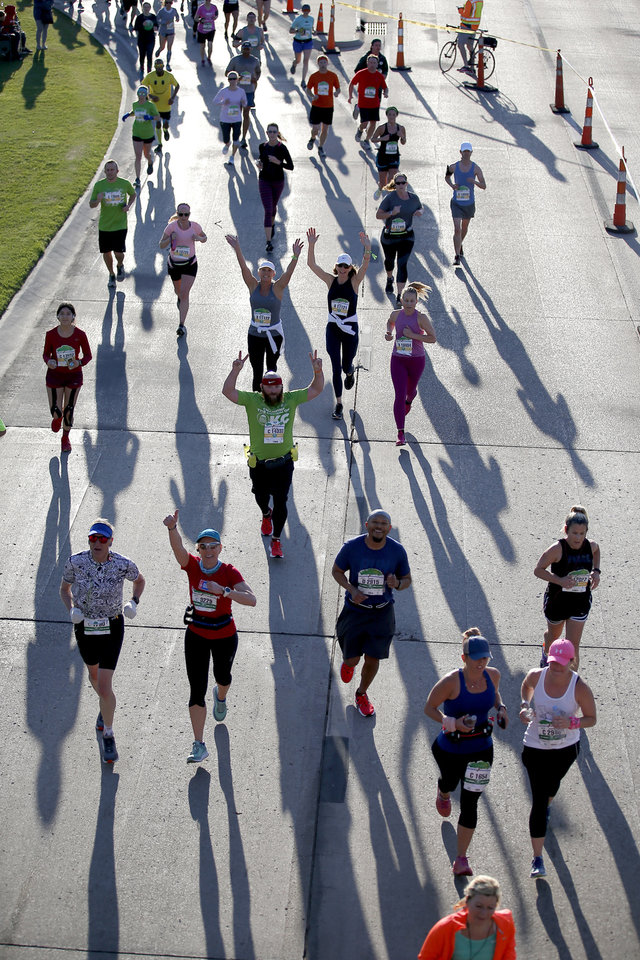 Photo - Runners run on NW 23rd St. during Oklahoma City Memorial Marathon in Oklahoma City, Sunday, April 28, 2019. [Sarah Phipps/The Oklahoman]