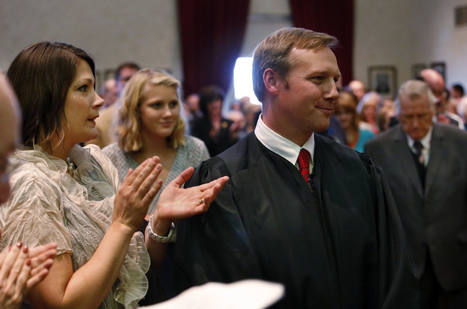 Photo - Thad Balkman is sworn in as district judge.  Beside him is wife Amy and behind is daughter Adeline, 15.  Photo by Steve Sisney, The Oklahoman  Steve Sisney - STEVE SISNEY