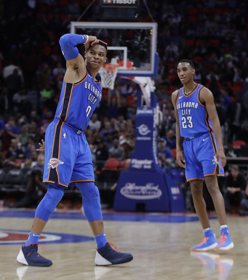 Photo -  Thunder guard Russell Westbrook celebrates after a three-point basket during the second half Saturday in Detroit. [AP PHOTO]