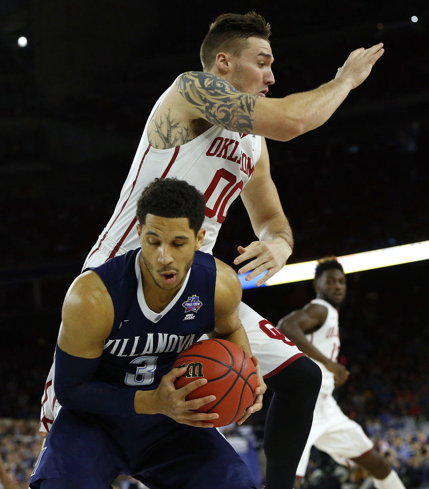 Photo - Villanova's Josh Hart (3) goes under Oklahoma's Ryan Spangler (00) during the national semifinal between the Oklahoma Sooners (OU) and the Villanova Wildcats in the Final Four of the NCAA Men's Basketball Championship at NRG Stadium in Houston, Saturday, April 2, 2016. Photo by Nate Billings, The Oklahoman