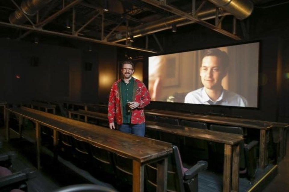 Photo -  Hunter Wheat hoped a two-screen cinema set up for drinks and food, along with an adjoining pub, would draw crowds to Banquet Cinema Pub at 800 NW 4. The venue will show its last movies Saturday night. [BRYAN TERRY/THE OKLAHOMAN]