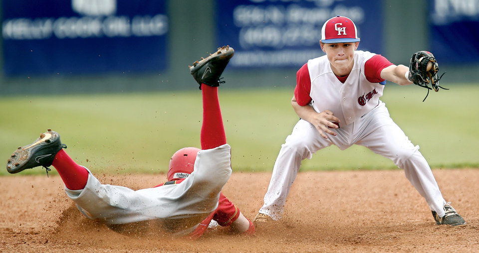 Photo - With the ball in his glove, Christian Heritage shortstop  is unable to make the tag on Dale's Jared Rogers before sliding safely at second base during  the Class 2A state quarterfinal game at Shawnee High School Thursday, May 9, 2019. Dale advances to the next round of playoffs, defeating Christian Heritage, 11-0.   [Jim Beckel/The Oklahoman]