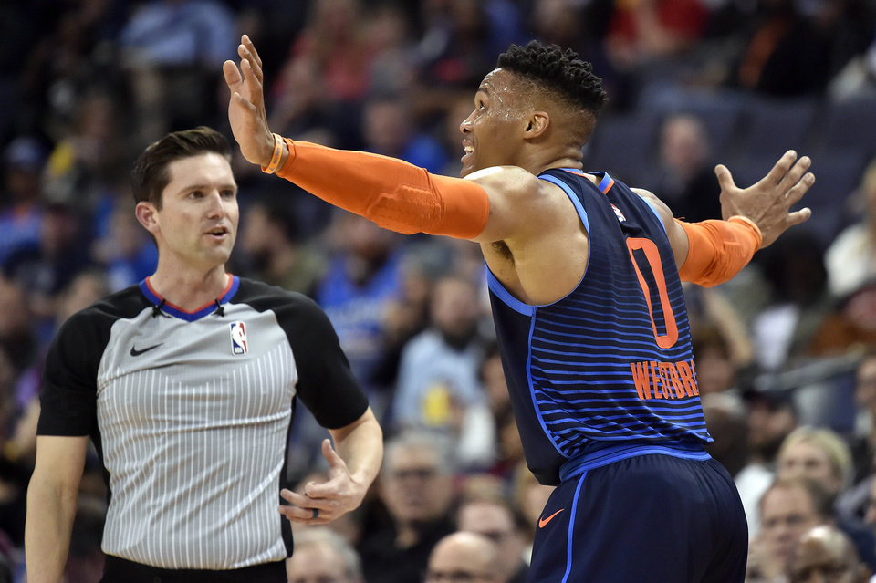 Photo - Oklahoma City Thunder guard Russell Westbrook (0) reacts to a ruling by referee Ben Taylor, left, during the first half of the team's NBA basketball game against the Memphis Grizzlies on Monday, March 25, 2019, in Memphis, Tenn. (AP Photo/Brandon Dill)