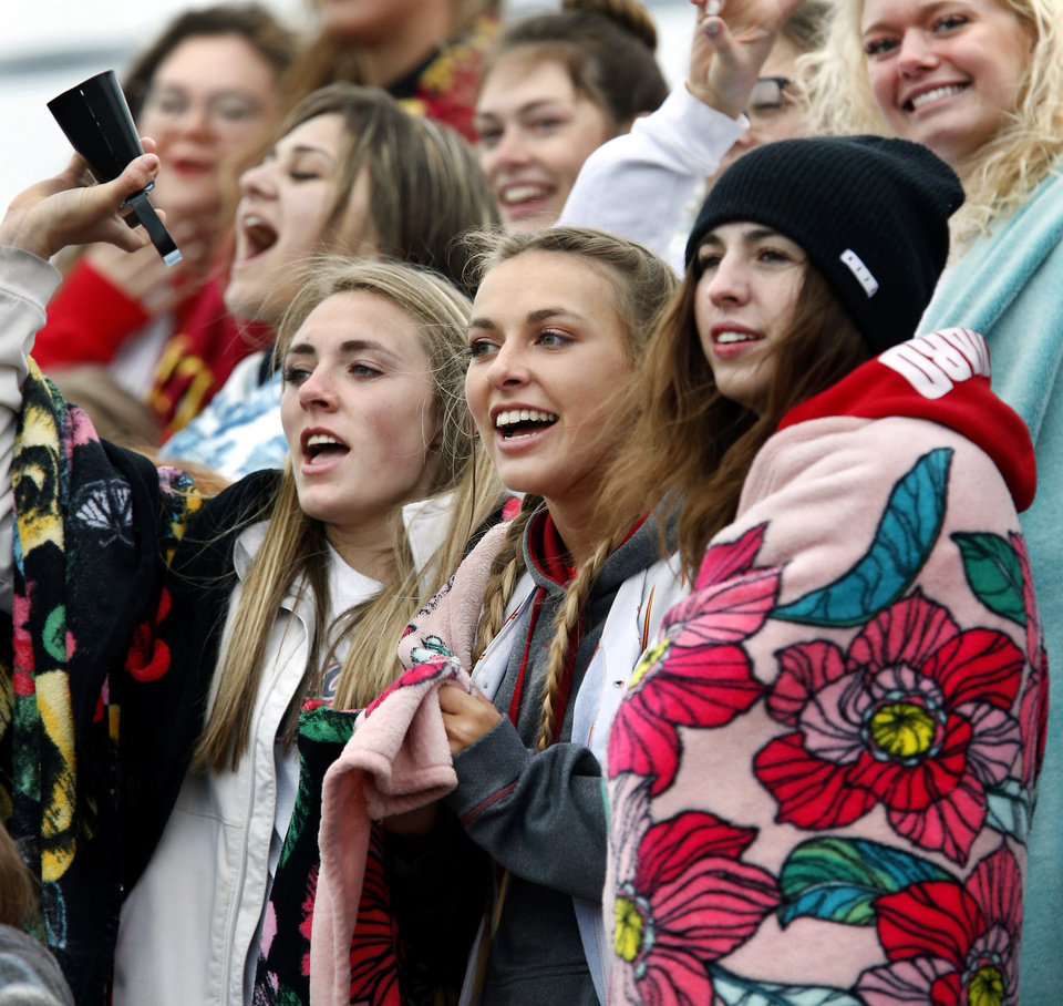 Photo - Bundled against unseasonably cool temperatures and northerly winds, Dale High School students cheer a hit by their baseball team during the Class 2A state quarterfinal game at Shawnee High School Thursday, May 9, 2019. Dale advances to the next round of playoffs, defeating Christian Heritage, 11-0.   [Jim Beckel/The Oklahoman]