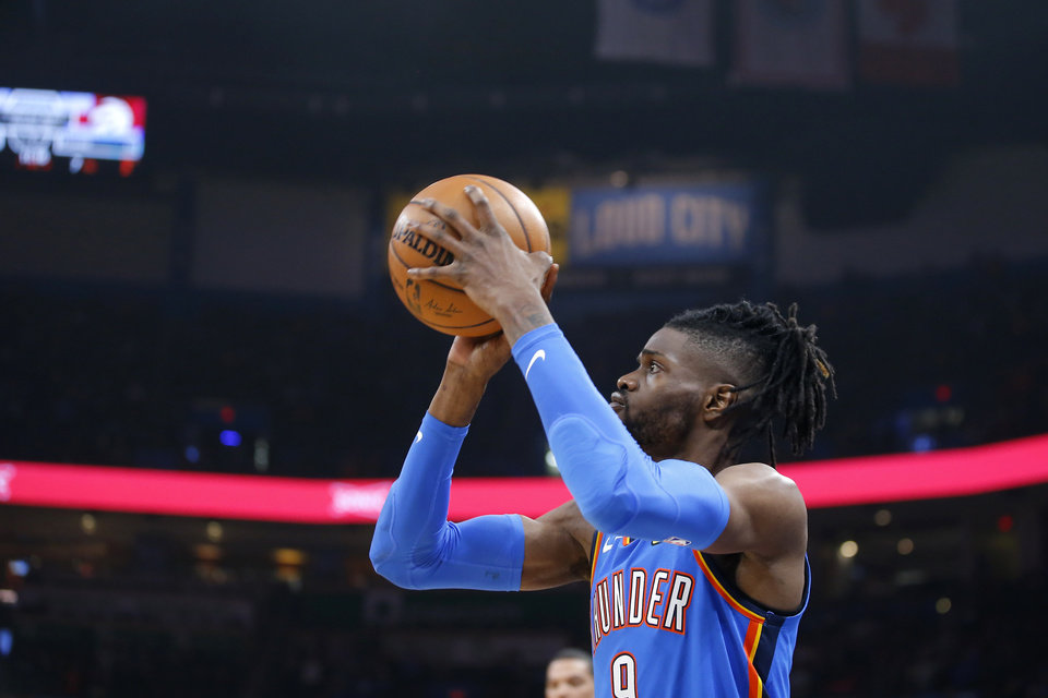 Photo - Oklahoma City's Nerlens Noel (9)  makes a 3-pointer during an NBA basketball game between the Oklahoma City Thunder and the Miami Heat at Chesapeake Energy Arena in Oklahoma City, Friday, Jan. 17, 2020. Oklahoma State lost 76-64. [Bryan Terry/The Oklahoman]