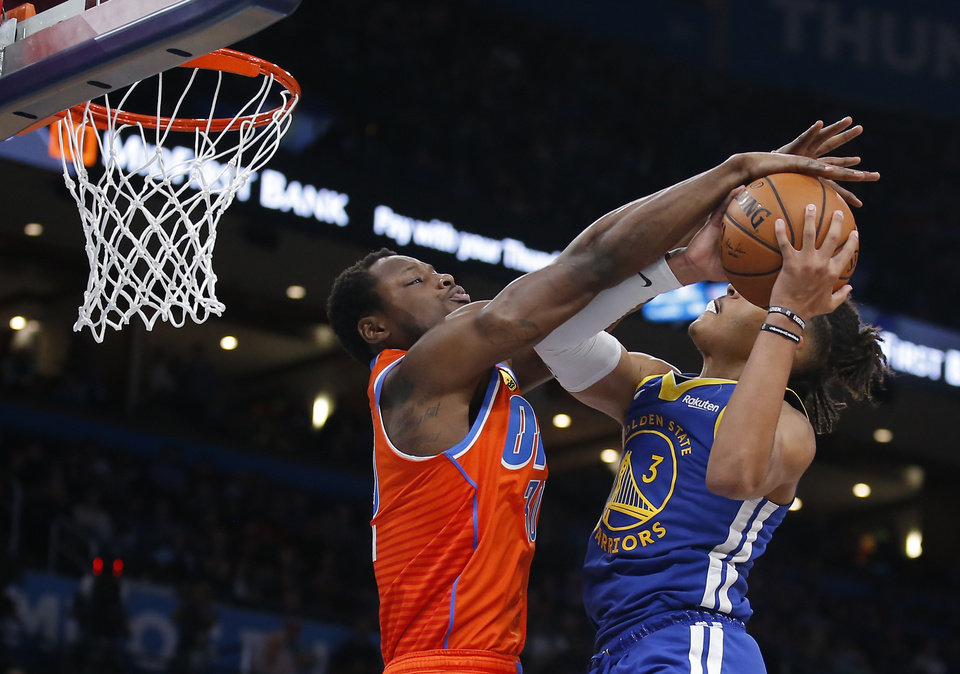 Photo - Oklahoma City's Deonte Burton (30) defends against Golden State's Jordan Poole (3) as he goes to the basket during the NBA game between the Oklahoma City Thunder and Golden State Warriors at Chesapeake Energy Arena,  Sunday, Oct. 27, 2019. Thunder won 120-92.[Sarah Phipps/The Oklahoman]