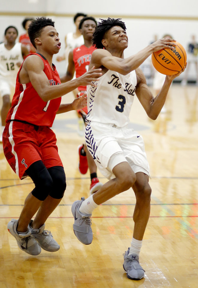 Photo - Heritage Hall's Kenneth Daughty goes up for a basket as Carl Albert's Roderick Hopkins defends during the high school boys game between Heritage Hall and Carl Albert at Heritage Hall in Oklahoma City, Friday, Jan. 17, 2020.  [Sarah Phipps/The Oklahoman]