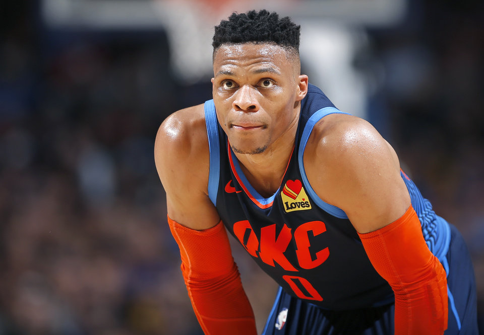 Photo - Oklahoma City's Russell Westbrook (0) watches a free throw during the NBA basketball game between the Oklahoma City Thunder and the Golden State Warriors at Chesapeake Energy Arena,  Saturday, March 16, 2019. Photo by Sarah Phipps, The Oklahoman