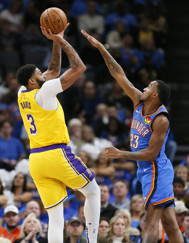 Photo - Los Angeles' Anthony Davis (3) shoots as Oklahoma City's Terrance Ferguson (23) defends in the second quarter during an NBA basketball game between the Oklahoma City Thunder and the Los Angeles Lakers at Chesapeake Energy Arena in Oklahoma City, Friday, Nov. 22, 2019. [Nate Billings/The Oklahoman]