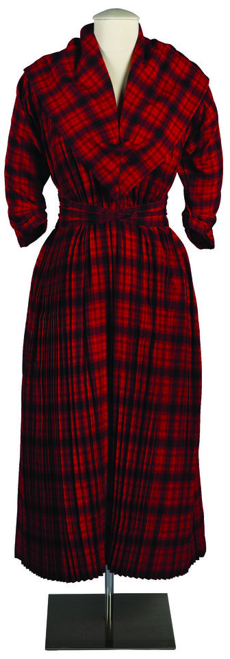 Photo -  This black and red plaid dress was created, owned and worn by Claire McCardell in 1945. [Photo provided by Maryland Historical Society]