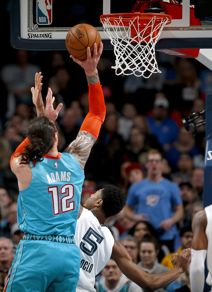 Photo - Oklahoma City's Steven Adams (12) shoots over Memphis' Bruno Caboclo (5) during the NBA basketball game between the Oklahoma City Thunder and the Memphis Grizzlies at the Chesapeake Energy Arena, Sunday, March 3, 2019. Photo by Sarah Phipps, The Oklahoman