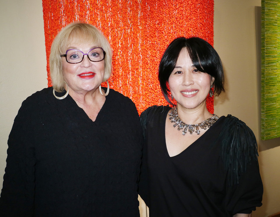 Photo - Joy Reed Belt with the artist Karam Cheong during Paseo First Friday art walk at JRB Art at the Elms, Friday, November 4, 2016. Photo by Doug Hoke