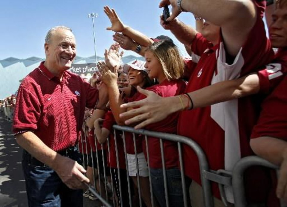 Photo -  Former Oklahoma coach Barry Switzer greets Longhorn and Sooner fans as he arrives for the Red River Rivalry college football game between the University of Oklahoma Sooners ( OU) and the University of Texas Longhorns (UT) at the Cotton Bowl on Saturday, Oct. 2, 2010, in Dallas, Texas. Photo by Chris Landsberger, The Oklahoman ORG XMIT: KOD
