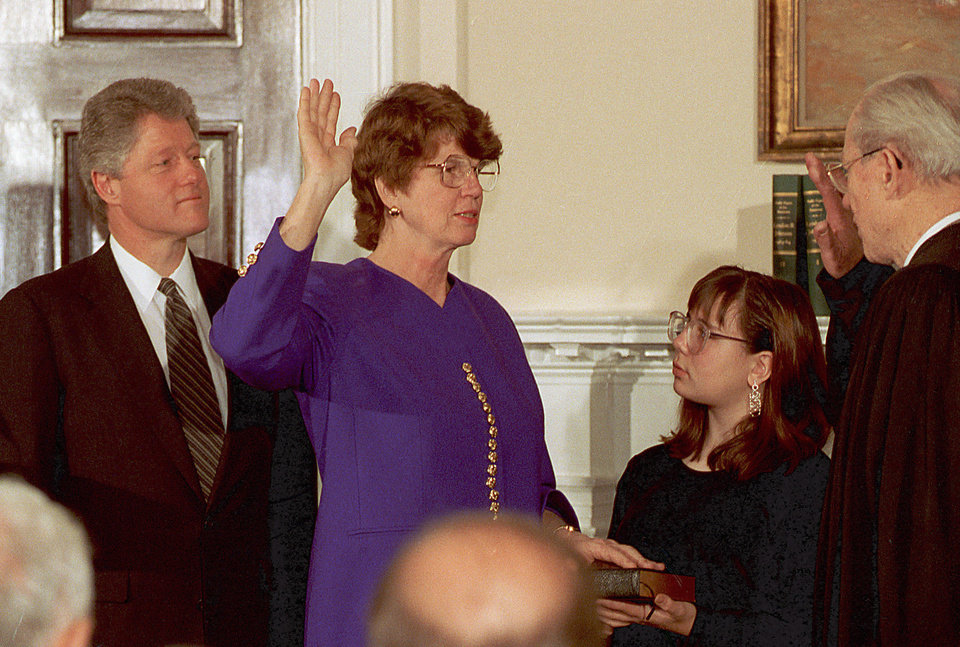 Photo - FILE - In this Friday, March 12, 1993, file photo, Supreme Court Justice Byron White, right, administers the oath of office to Janet Reno making her Attorney General during a ceremony at the White House in Washington, D.C. Reno, the first woman to serve as U.S. attorney general and the epicenter of several political storms during the Clinton administration, has died early Monday, Nov. 7, 2016. She was 78. At left is U.S. President Bill Clinton. (AP Photo/Barry Thumma)