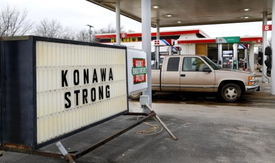 Photo -  Sign at a convenience store near downtown Konawa pledging support for the town and school. Konawa Middle School athlete Rhindi Kay Isaacs, 12, was among three people who died in a fiery, head-on collision Friday evening. The Konawa Public School District said six students from the  junior high school girls softball team were aboard the bus  traveling home at the time of the crash. The team's coach was driving the bus when it was struck by an SUV on SH 377, between Bowlegs and Konawa, in Seminole County. The Oklahoma Highway Patrol said the SUV was traveling in the northbound lane just after 7 p.m. when it swerved and collided with a Konawa School activity bus after the driver of the SUV swerved when passing another vehicle,   The driver and passenger were pinned inside the SUV when it caught fire. Both were pronounced dead on the scene from what authorities described as þÄúmassive injuries.þÄù   Monday, March 11, 2019. .Photo by Jim Beckel, The Oklahoman.